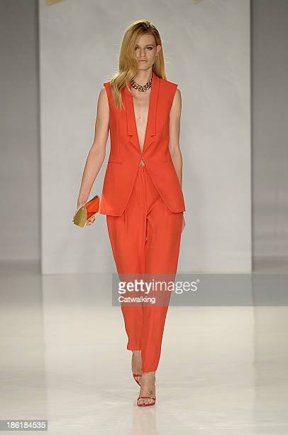 A model walks the runway at the Genny Spring Summer 2014 fashion show during Milan Fashion Week on September 23 2013 in Milan Italy