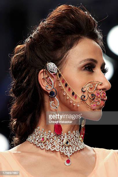 A model walks the runway at the GIA show on day 3 of India International Jewellery Week 2013 at the Hotel Grand Hyatt on August 6 2013 in Mumbai India