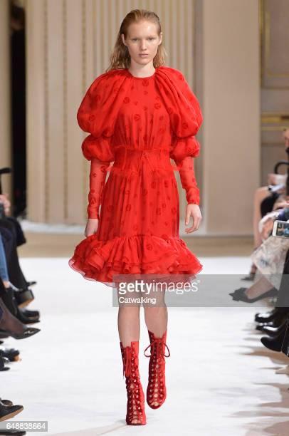 A model walks the runway at the Giambattista Valli Autumn Winter 2017 fashion show during Paris Fashion Week on March 6 2017 in Paris France