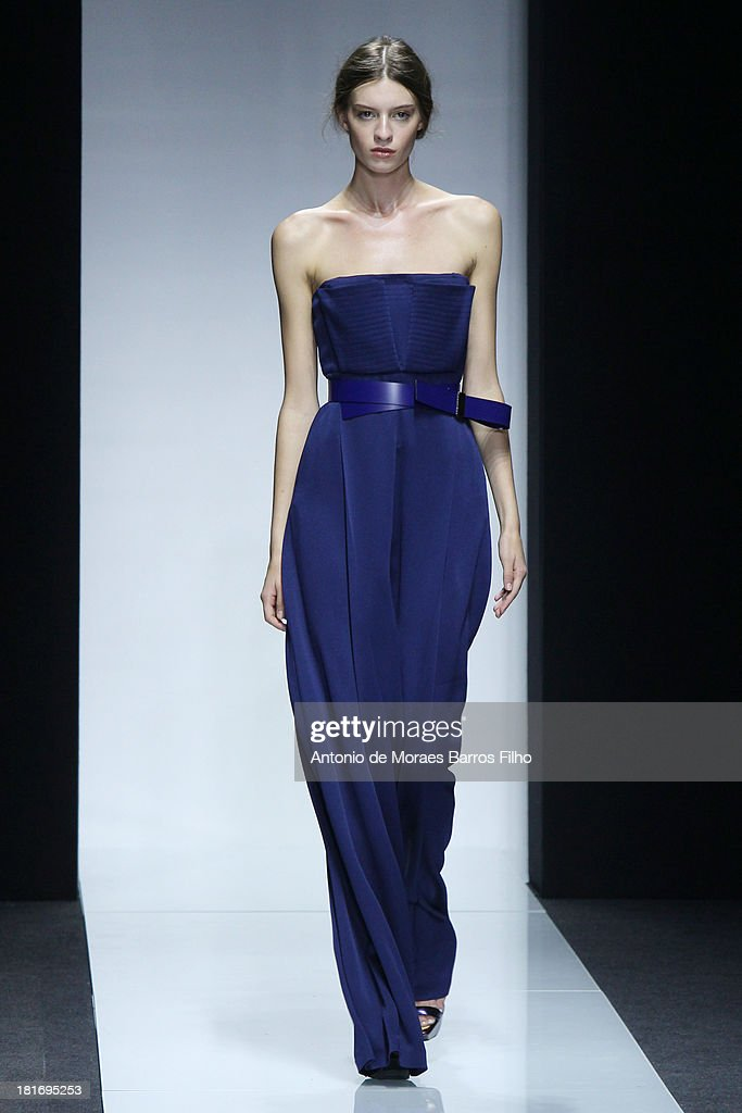 A model walks the runway at the Gianfranco Ferre show as part of Milan Fashion Week Womenswear Spring/Summer 2014 on September 23, 2013 in Milan, Italy.