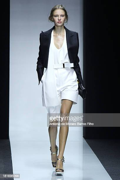 A model walks the runway at the Gianfranco Ferre show as part of Milan Fashion Week Womenswear Spring/Summer 2014 on September 23 2013 in Milan Italy
