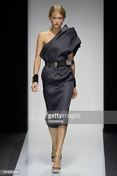 A model walks the runway at the Gianfranco Ferre Spring Summer 2014 fashion show during Milan Fashion Week on September 23 2013 in Milan Italy