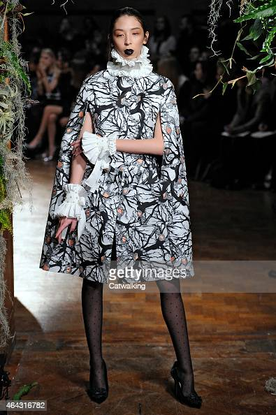 A model walks the runway at the Giles Autumn Winter 2015 fashion show during London Fashion Week on February 23 2015 in London United Kingdom