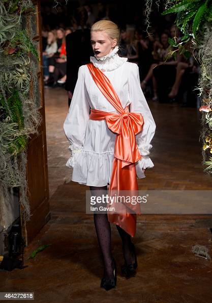 A model walks the runway at the GILES show during London Fashion Week Fall/Winter 2015/16 at Central Saint Martins on February 23 2015 in London...