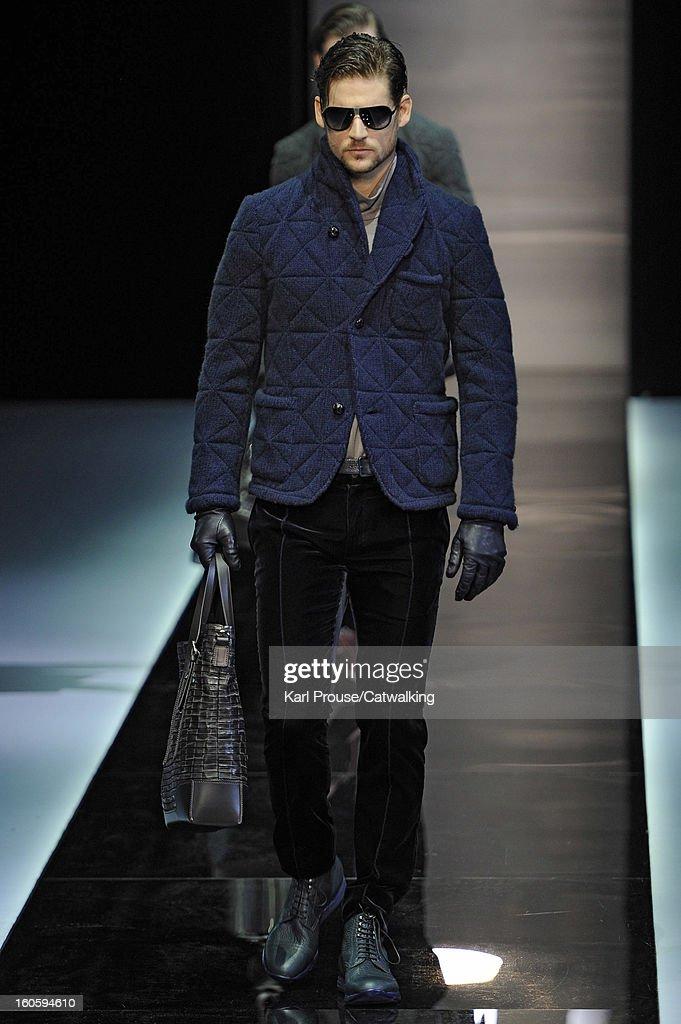 A model walks the runway at the Giorgio Armani Autumn Winter 2013 fashion show during Milan Menswear Fashion Week on January 15, 2013 in Milan, Italy.