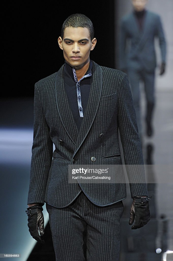 A model walks the runway at the Giorgio Armani Autumn Winter 2013 fashion show during Milan Menswear Fashion Week on January 15, 2013 in Milan, Italy.