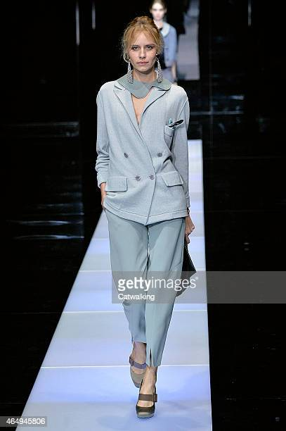 A model walks the runway at the Giorgio Armani Autumn Winter 2015 fashion show during Milan Fashion Week on March 2 2015 in Milan Italy