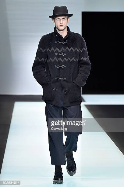 A model walks the runway at the Giorgio Armani Autumn Winter 2016 fashion show during Milan Menswear Fashion Week on January 19 2016 in Milan Italy