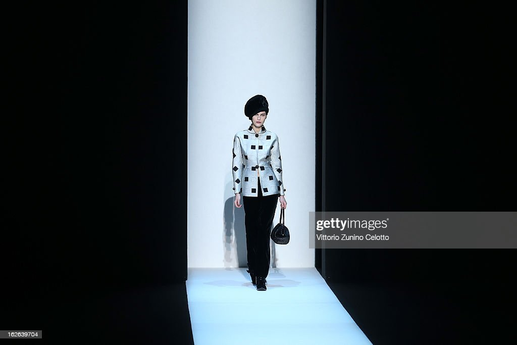A model walks the runway at the Giorgio Armani fashion show as part of Milan Fashion Week Womenswear Fall/Winter 2013/14 on February 25, 2014 in Milan, Italy.