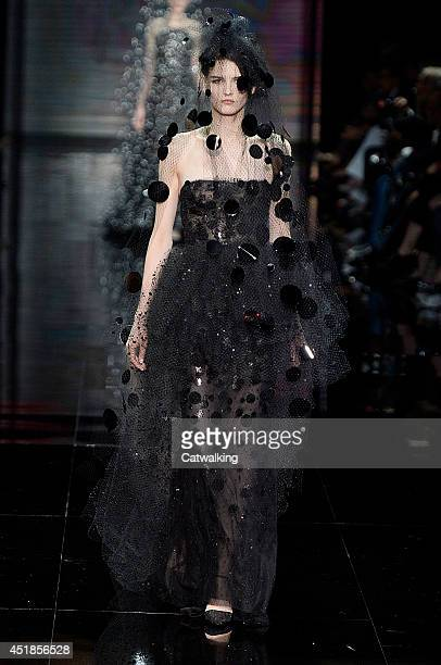 A model walks the runway at the Giorgio Armani Prive Autumn Winter 2014 fashion show during Paris Haute Couture Fashion Week on July 8 2014 in Paris...