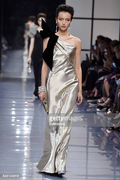 A model walks the runway at the Giorgio Armani Prive Autumn Winter 2016 fashion show during Paris Haute Couture Fashion Week on July 5 2016 in Paris...