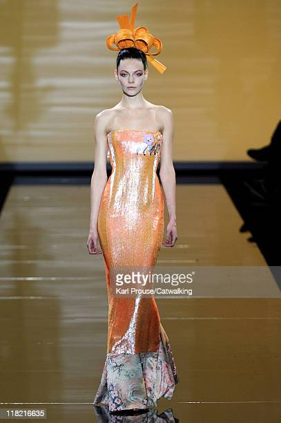 A model walks the runway at the Giorgio Armani Prive Haute Couture autumn winter 2011 fashion show during Paris Haute Couture Week on July 5 2011 in...