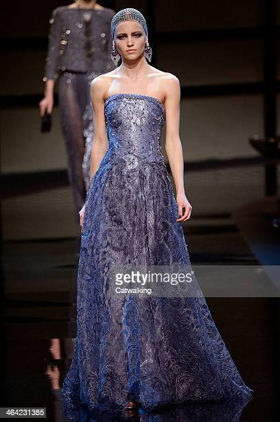 A model walks the runway at the Giorgio Armani Prive Spring Summer 2014 fashion show during Paris Haute Couture Fashion Week on January 21 2014 in...