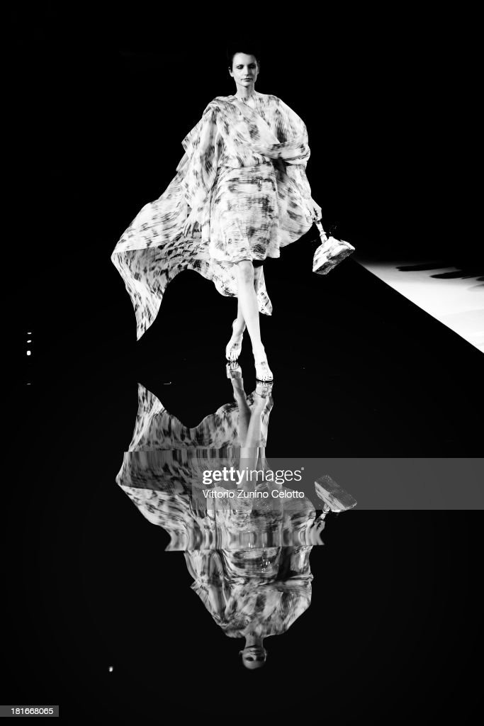 A model walks the runway at the Giorgio Armani show as a part of Milan Fashion Week Womenswear Spring/Summer 2014 at on September 23, 2013 in Milan, Italy.