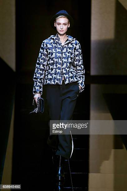 A model walks the runway at the Giorgio Armani show during Milan Men's Fashion Week Fall/Winter 2017/18 on January 17 2017 in Milan Italy