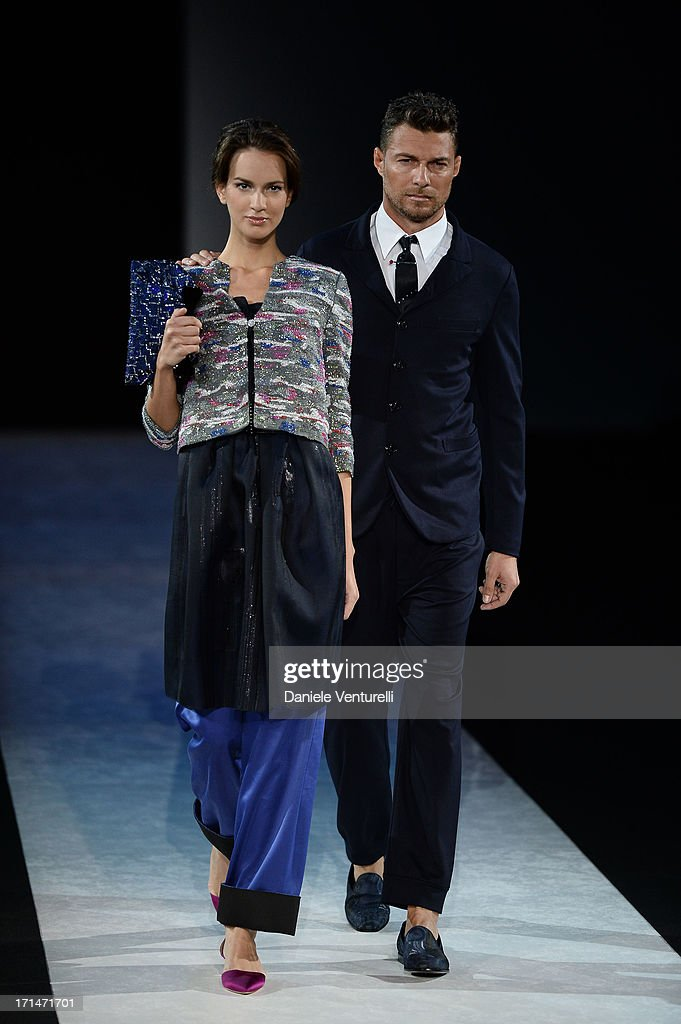 A model walks the runway at the Giorgio Armani show during Milan Menswear Fashion Week Spring Summer 2014 on June 25, 2013 in Milan, Italy.