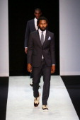 A model walks the runway at the Giorgio Armani show during Milan Menswear Fashion Week Spring Summer 2014 on June 25 2013 in Milan Italy
