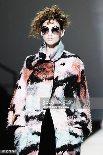 A model walks the runway at the Giorgio Armani show during Milan Fashion Week Fall/Winter 2016/17 on February 29 2016 in Milan Italy