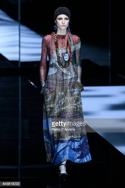 A model walks the runway at the Giorgio Armani show during Milan Fashion Week Fall/Winter 2017/18 on February 27 2017 in Milan Italy