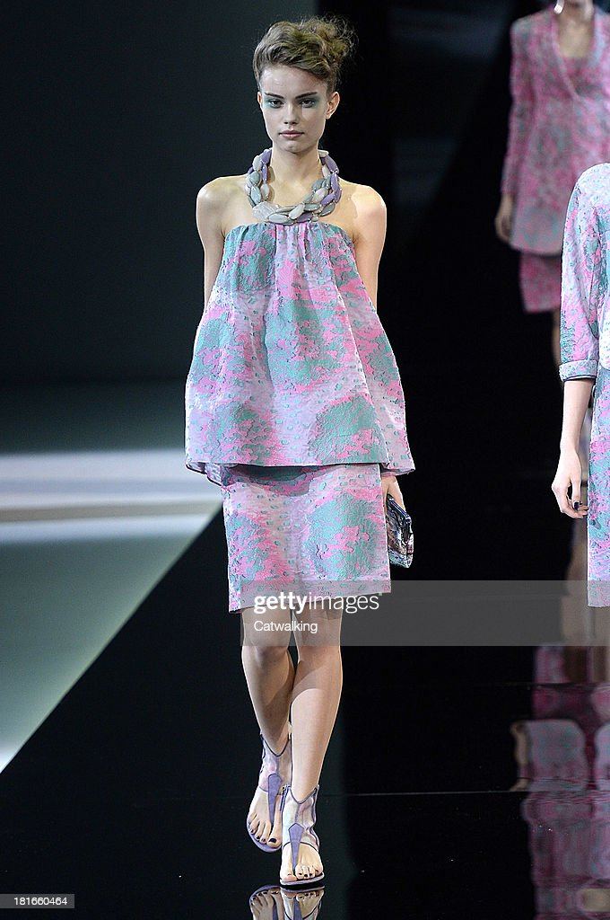 A model walks the runway at the Giorgio Armani Spring Summer 2014 fashion show during Milan Fashion Week on September 23, 2013 in Milan, Italy.