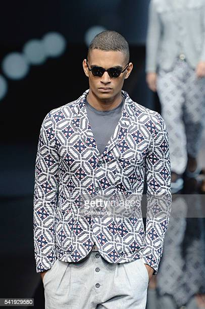 A model walks the runway at the Giorgio Armani Spring Summer 2017 fashion show during Milan Menswear Fashion Week on June 21 2016 in Milan Italy