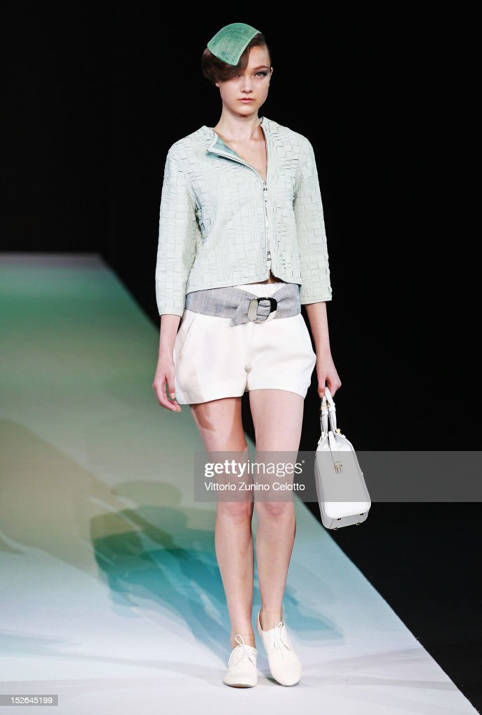 A model walks the runway at the Giorgio Armani Spring/Summer 2013 fashion show as part of Milan Womenswear Fashion Week on September 23 2012 in Milan...