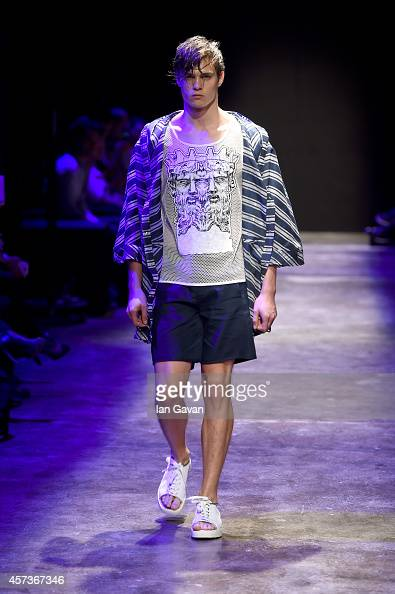 A model walks the runway at the Giray Sepin show during Mercedes Benz Fashion Week Istanbul SS15 at Antrepo 3 on October 17 2014 in Istanbul Turkey