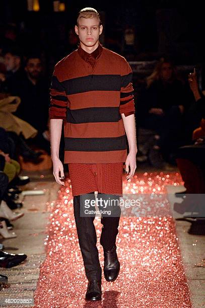 A model walks the runway at the Givenchy Autumn Winter 2015 fashion show during Paris Menswear Fashion Week on January 23 2015 in Paris France