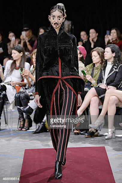 A model walks the runway at the Givenchy Autumn Winter 2015 fashion show during Paris Fashion Week on March 8 2015 in Paris France
