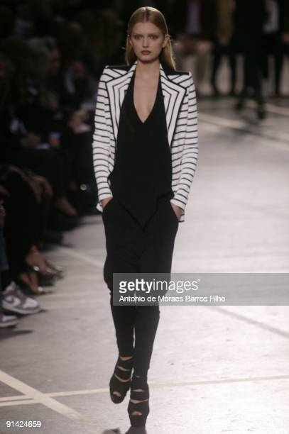 A model walks the runway at the Givenchy PretaPorter show during Paris Womenswear Fashion Week Spring/Summer 2010 on October 4 2009 in Paris France