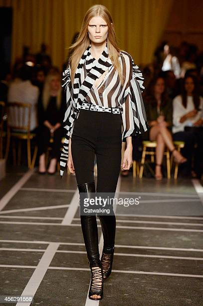 A model walks the runway at the Givenchy Spring Summer 2015 fashion show during Paris Fashion Week on September 28 2014 in Paris France