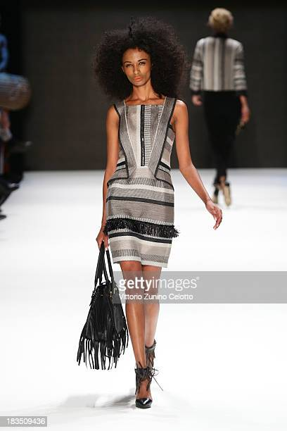 A model walks the runway at the Gizia show during MercedesBenz Fashion Week Istanbul s/s 2014 on October 7 2013 in Istanbul Turkey