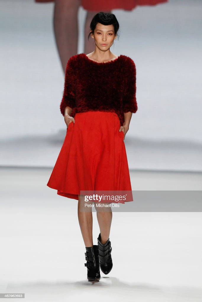 A model walks the runway at the Glaw show during MercedesBenz Fashion Week Autumn/Winter 2014/15 at Brandenburg Gate on January 16 2014 in Berlin...