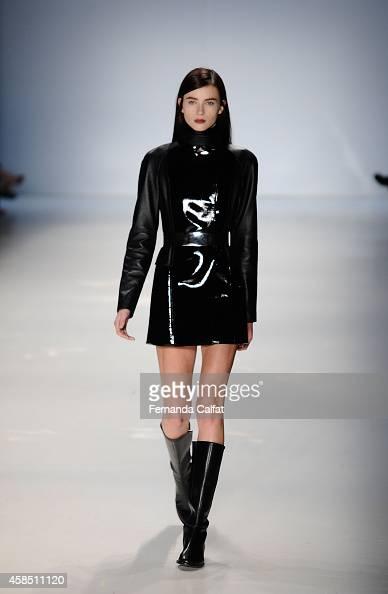A model walks the runway at the Gloria Coelho fashion show during Sao Paulo Fashion Week Winter 2015 at Parque Candido Portinari on November 6 2014...