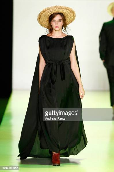 A model walks the runway at the GOGA NIKABADZE show during MercedesBenz Fashion Week Russia S/S 2014 on October 27 2013 in M