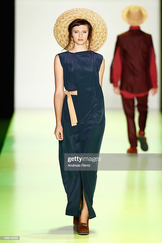 A model walks the runway at the GOGA NIKABADZE show during Mercedes-Benz Fashion Week Russia S/S 2014 on October 27, 2013 in M