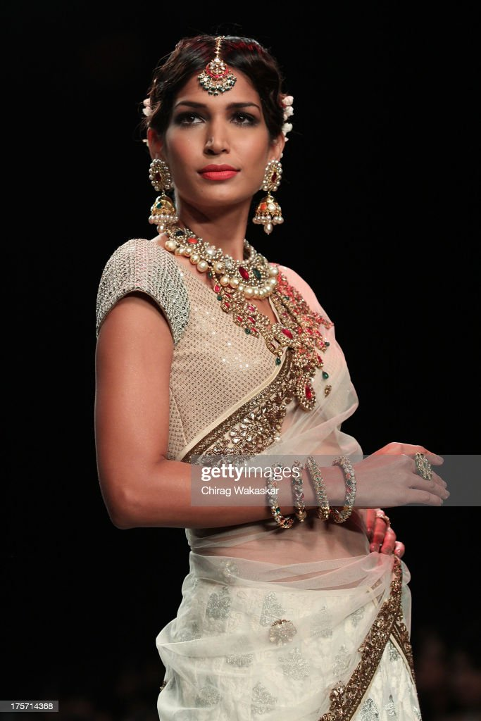 A model walks the runway at the Golecha's Jewels show on day 3 of India International Jewellery Week 2013 at the Hotel Grand Hyatt on August 6, 2013 in Mumbai, India.