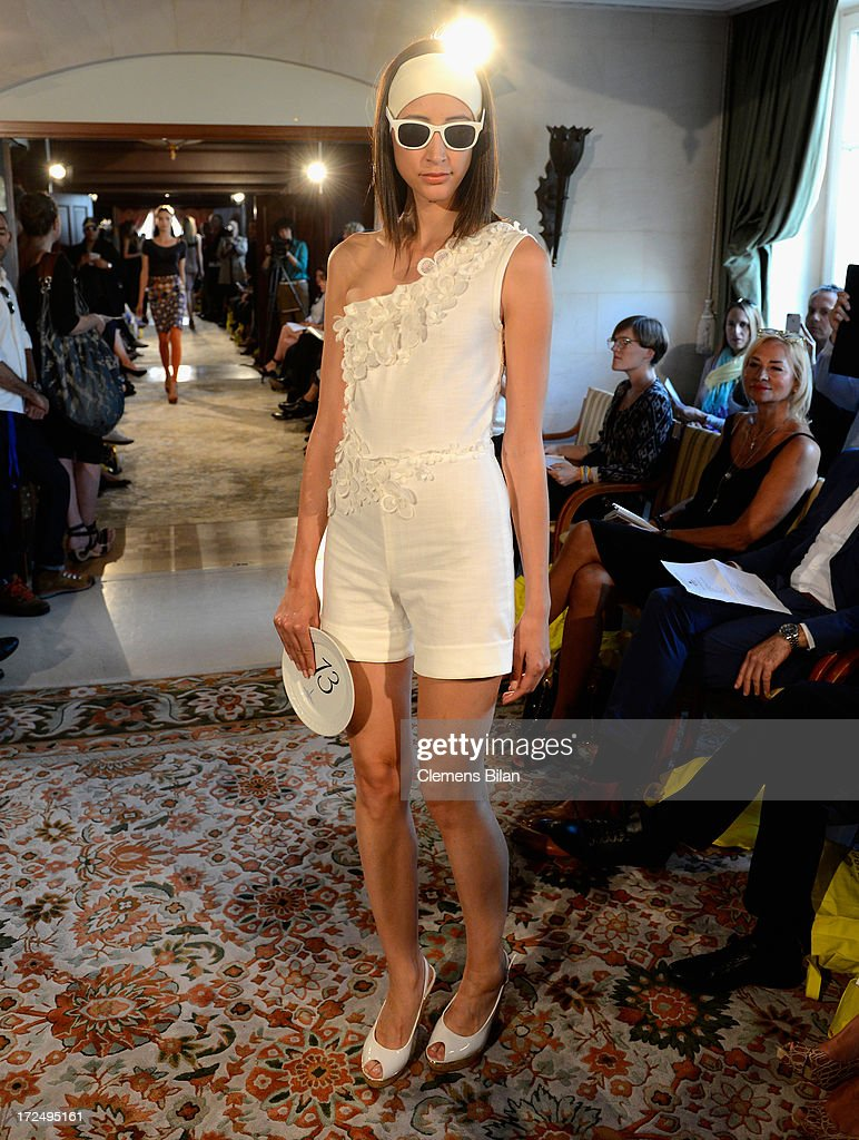 A model walks the runway at the Green Showroom during Mercedes-Benz Fashion Week Spring/Summer 2014 at Brandenburg Gate on July 2, 2013 in Berlin, Germany.