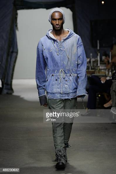 A model walks the runway at the Greg Lauren SS15 Collection at the Eyebeam during MercedesBenz Fashion Week 2015 on September 10 2014 in New York City