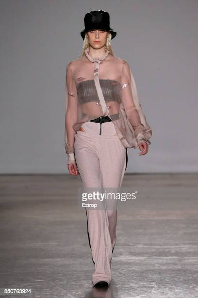 A model walks the runway at the Grinko show during Milan Fashion Week Spring/Summer 2018 on September 20 2017 in Milan Italy