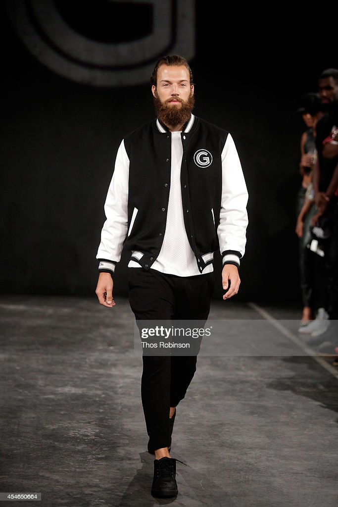 A model walks the runway at the Grungy Gentleman Presentation during Mercedes-Benz Fashion Week Spring 2015 at The Hub at The Hudson Hotel on September 4, 2014 in New York City.
