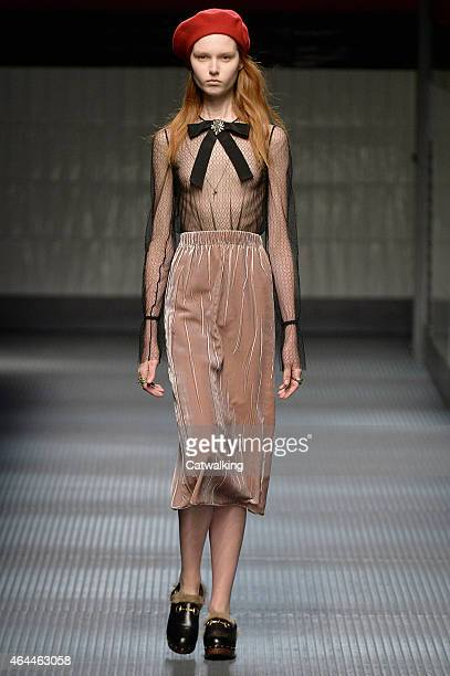 A model walks the runway at the Gucci Autumn Winter 2015 fashion show during Milan Fashion Week on February 25 2015 in Milan Italy