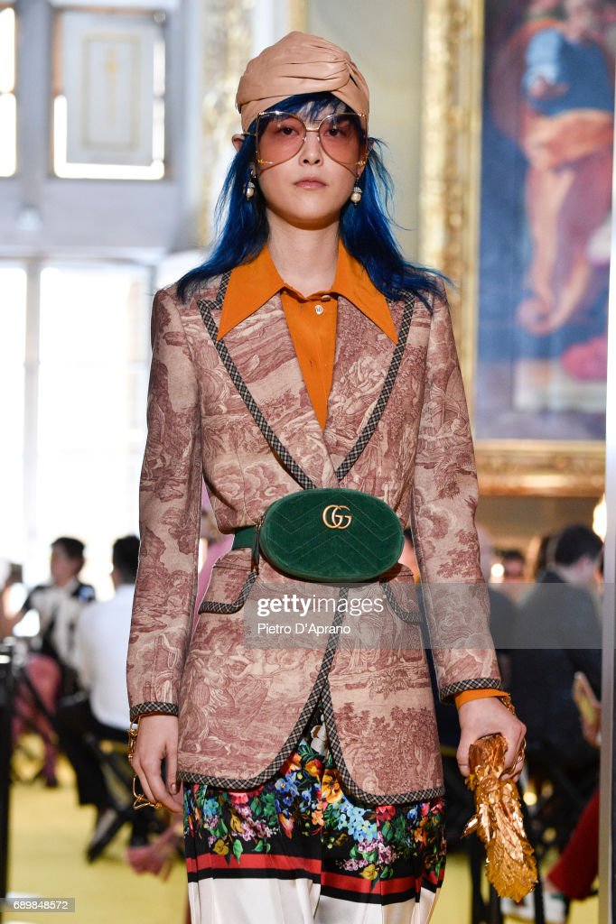 A model walks the runway at the Gucci Cruise 2018 show at Palazzo Pitti on May 29, 2017 in Florence, Italy.