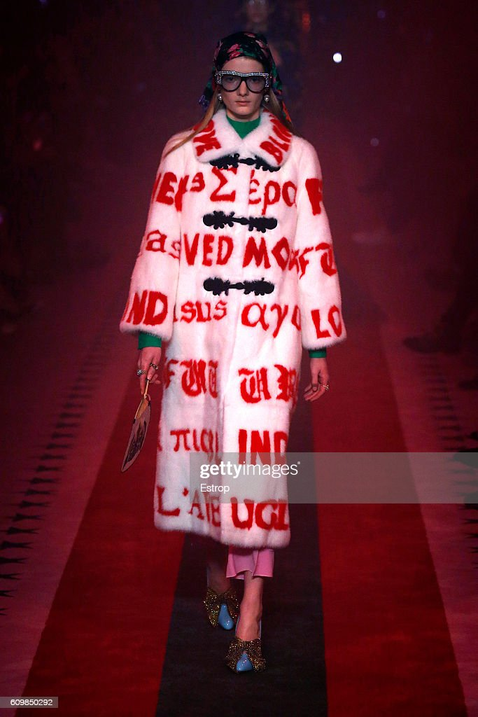 model-walks-the-runway-at-the-gucci-designed-by-alessandro-michele-picture-id609850292