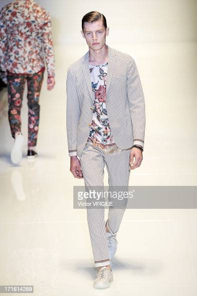 A model walks the runway at the Gucci show during Milan Menswear Fashion Week Spring Summer 2014 show on June 24 2013 in Milan Italy