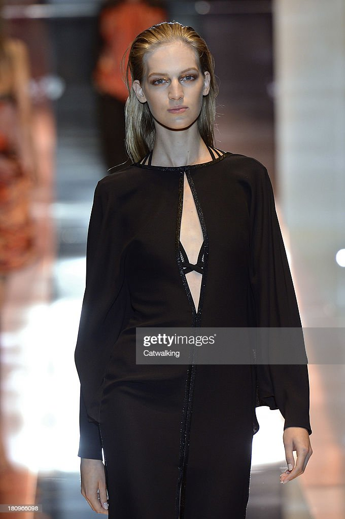 A model walks the runway at the Gucci Spring Summer 2014 fashion show during Milan Fashion Week on September 18, 2013 in Milan, Italy.