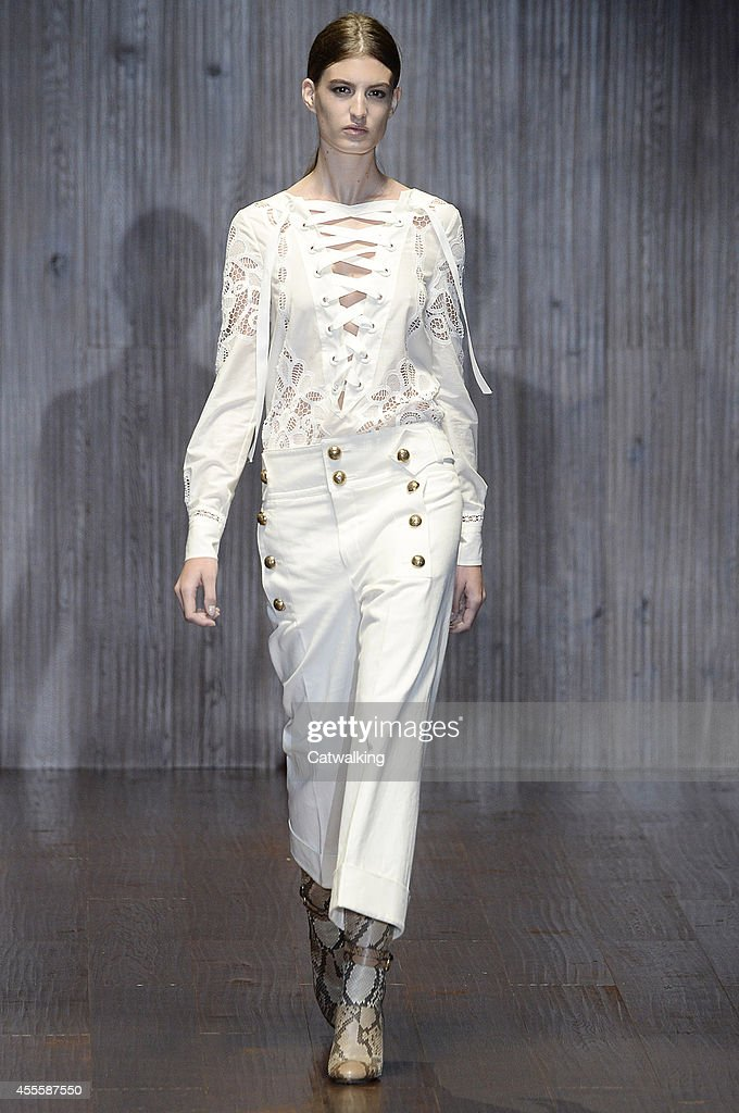 A model walks the runway at the Gucci Spring Summer 2015 fashion show during Milan Fashion Week on September 17 2014 in Milan Italy