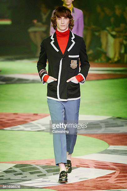 A model walks the runway at the Gucci Spring Summer 2017 fashion show during Milan Menswear Fashion Week on June 20 2016 in Milan Italy