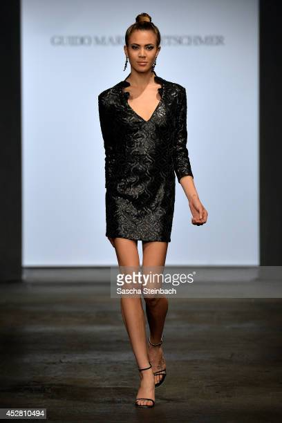 A model walks the runway at the Guido Maria Kretschmer Show during Platform Fashion Dusseldorf on July 27 2014 in Duesseldorf Germany