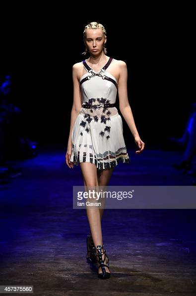 A model walks the runway at the Gulcin Cengel show during Mercedes Benz Fashion Week Istanbul SS15 at Antrepo 3 on October 17 2014 in Istanbul Turkey